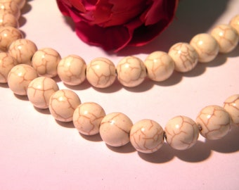 25 beads summary - ivory - 10 mm howlite with visible crazing - H36