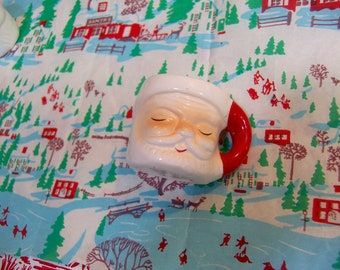miniature santa mug with with closed eyes