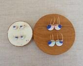 Shield Stud Earrings...