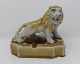 Old ashtray with roaring lion, free delivery