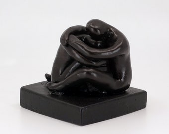 """Friends hugging sculpture   long-distance hug   2018 """"Held"""" limited-edition, cast-stone love statue"""