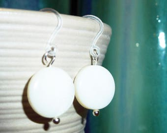 Simple lightweight white mother-of-pearl disc earrings on plastic french hooks for sensitive ears