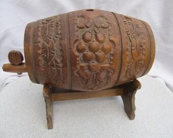 Old vintage wooden hand carved keg flask barrel with stand