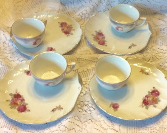 Vintage pre WWII German porcelain teacup and plates serving set.