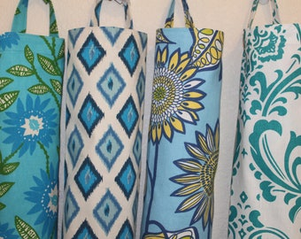 Plastic bag holders, grocery bag holders, plastic bag dispensers.