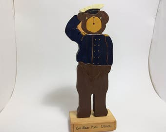 "wooden Marine bear figure (""Busy Bears"")"