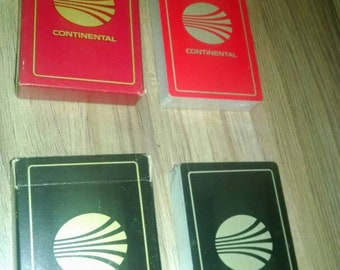 Vintage pair of Continental Airlines playing cards. Cards still in plastic. Red and black decks.