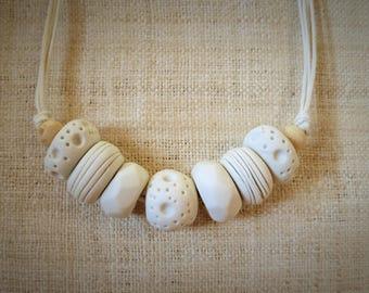 Primitive tribal design stoneware necklace