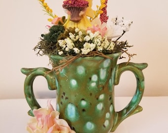 Fairy in green cup