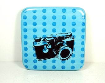 tile in blues with a Leica camera print. ready to ship