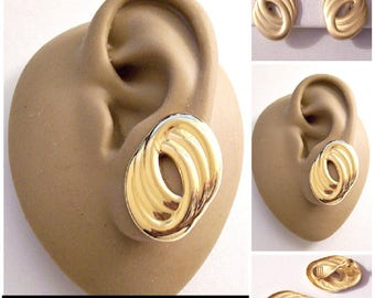 Monet Satin or Polished Rings Clip On Earrings Gold Tone Vintage Large Oval Layered Ribbed Open Center Discs Lined Backs Comfort Paddles