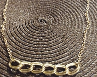 Gold necklace with wide link front
