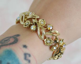 Vintage Gold Tone Metal Bracelet with AB Rhinestone Flowers