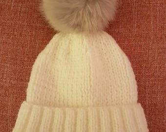 White babies beanie hat with faux fur grey pom pom