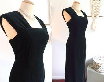 Black velvet close-fitting evening dress