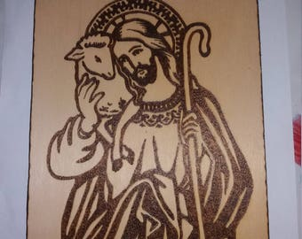Burning painting by hand. Jesus and Lamb