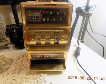 Vintage toy slot machine bank
