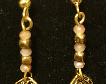 Gold leaf with gold and beige crystal stacked beads dangle earring.