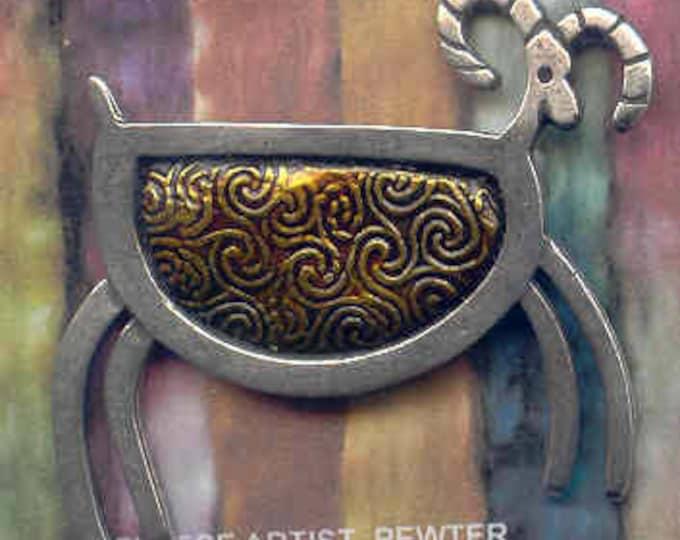 Brooch: GOLD pewter petroglyph sheep brooch.