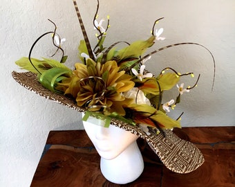 Brown and cream patterned hat with green accents