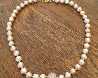 Rose colored freshwater pearl necklace with rose gold crystal bead