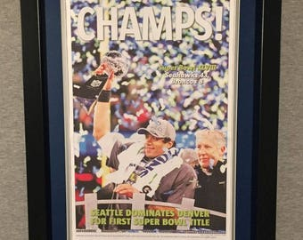 Seattle Seahawks 2014 Super Bowl XXVII Champions - The Seattle Times Front Page - Double Matted & Framed (Official Team Colors)
