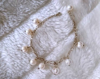 Modern bracelet with real pearls in white made of sterling silver (925)