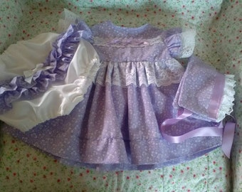 This is a beautiful and original outfit.  Made in lavender with silver floral pattern on the fabric.