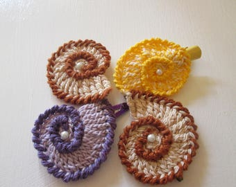 Handmade crochet clips snail-shaped.