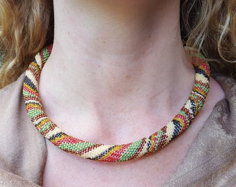 Gaia, soft toned beaded crochet necklace. Made with earth tones and inspired by nature.