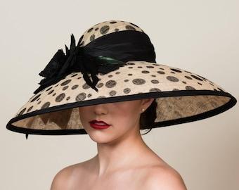 Wide Brim Kentucky Derby Hat in Polka Dots. Black Dots on Natural Sinamay Straw. Black Silk Taffeta Band. Black Silk Rose. Feathers.