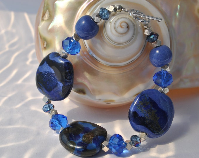 Brillant Blue African Kazuri Ceramic bracelet, with blue crystals and faceted sterling silver beads