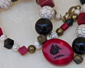 Primitive black white brass red coral necklace focal bead black agate white howlite beads African trader brass bead OOAK