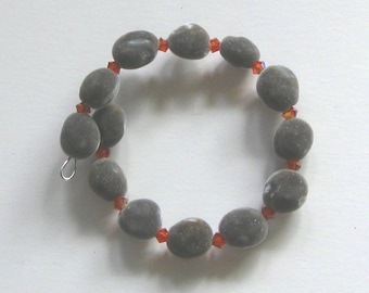 Hawaiian mgambo seed and Indian Red AB Swarovski crystal bracelet, handmade in Hilo, Hawaii
