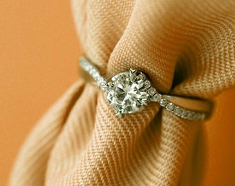 Infinity Ribbon Solitare Moissanite Engagement Ring (Tension Setting)