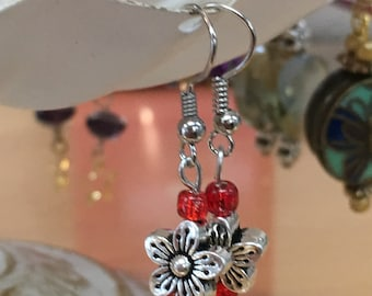 Boho Chic handmade Silver Flower Bead Earrings with Red accents.