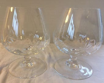A fine pair of cut glass vintage brandy balloon/ snifter glasses.
