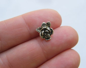 4 Flower head pins antique silver tone FS550