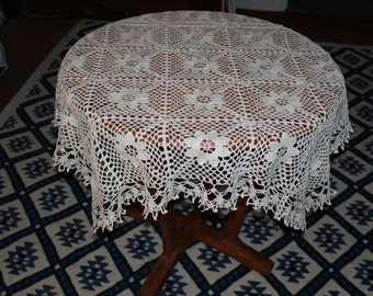 very decorative off-white crochet tabletops