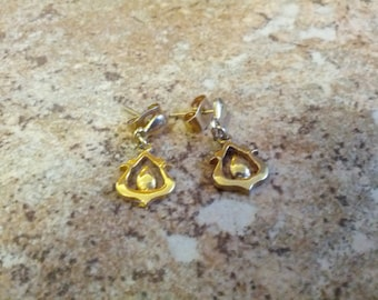 Lovely and dainty gold tone metal pierced earrings