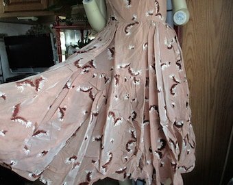 1950's hand made party prom dress in a sheer simmering mocha color with veleteen feathers