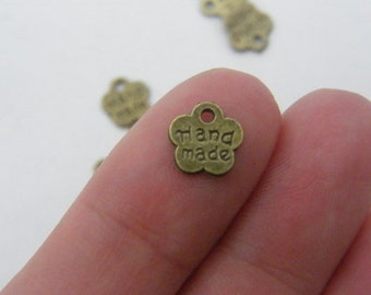 20 Hand made charms bronze tone BC111
