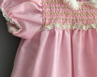 Vintage smocked pink dress with lace trim