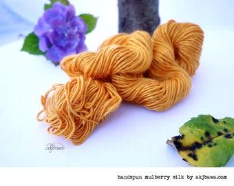 handspun orange mulberry silk single