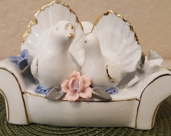 Vintage lovebirds on a love seat figurine