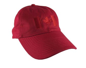 Canadian Flag Red Embroidery Design on a Cranberry Red Adjustable Unstructured Baseball Cap Dad Hat for a Tone on Tone Fashion Look