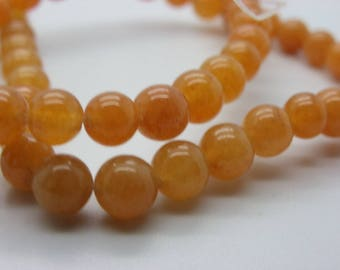 a 65, 68 beads about jade 6 mm round Topaz orange transparent