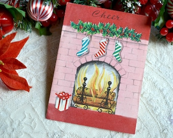 Vintage Christmas Card - Pink Fireplace and Stockings - Used
