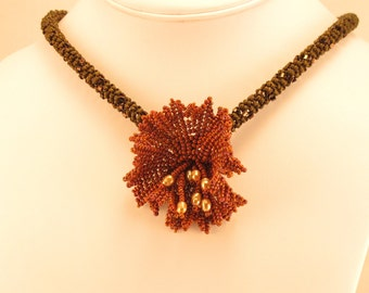 Necklace  Reddish brown herringbone flower with pearl stamens on a beaded rope