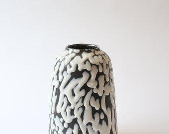 large ceramic vase with drippy white glaze